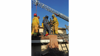 Calif. Firefighters Dismantle Chimney to Free Woman