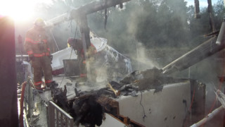 Sailboat Burns in Ore. Marina