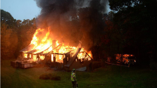 Photo Story: Former Cop Accused of Setting Conn. Fire