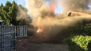 Video: Man Races Into Burning Fresno House to Make a Rescue