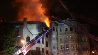 Photo Story: Ladders Used to Contain Boston Blaze