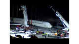 Aircraft lifted off LaGuardia fence