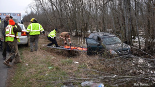 Photo Story: N.C. Crews Rescue Dog, Good Samaritan