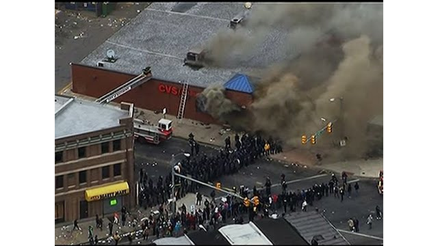 Raw: CVS Store Goes Up in Flames