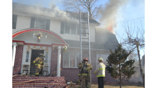 Photos: Family Escapes Mass. House Fire