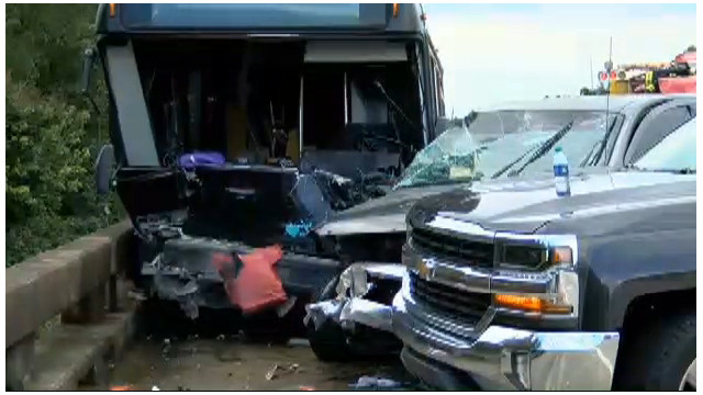 Flood volunteer bus hits firetruck; 2 dead, dozens hurt
