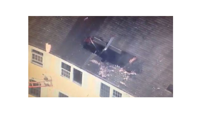 Plane strikes Methuen condo building; pilot killed