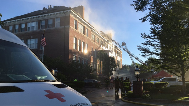 Firefighters battle seven-alarm fire at apartment building
