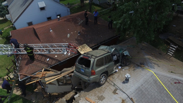 Speeding SUV crashes into roof of St. Louis home