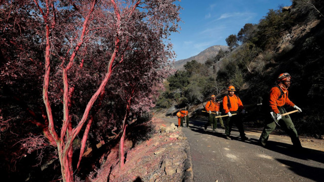 Firefighters brace for return of California winds