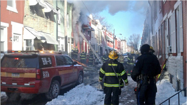 Philadelphia firefighters at the scene of a two-alarm fire in a North Colorado Street rowhome Saturday morning