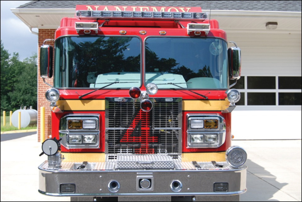 The rear body is equipped with aluminum tread plate covers to protect the hose load with enclosed compartments for hard suction hose. & Nanjemoyu0027s Spartan/Rosenbauer Pumper Apparatus