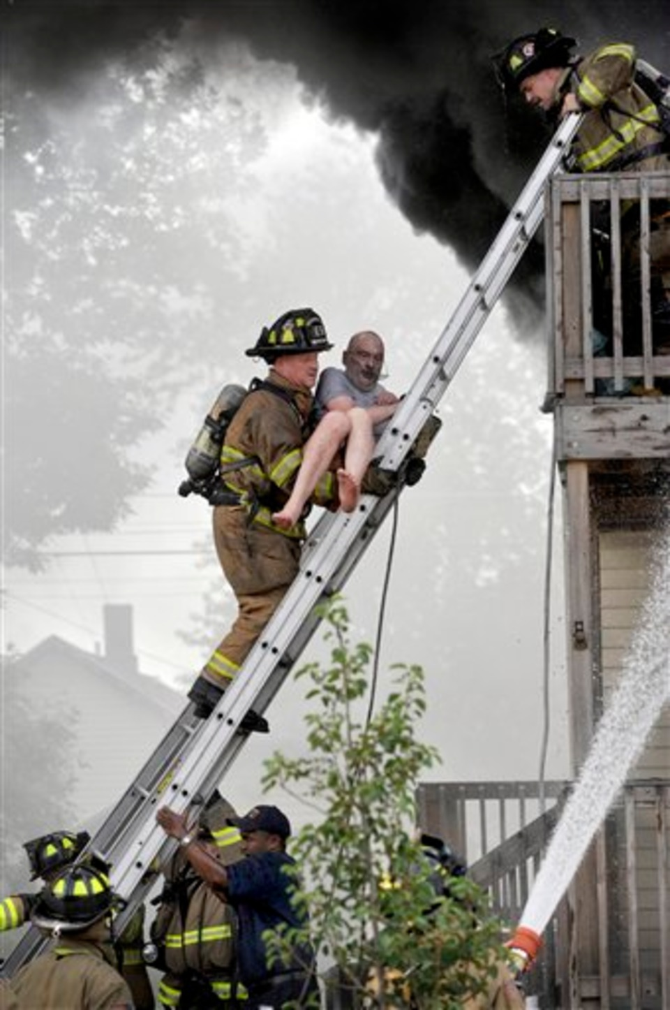 Racine Firefighters Rescue Pete Lui From Balcony Of