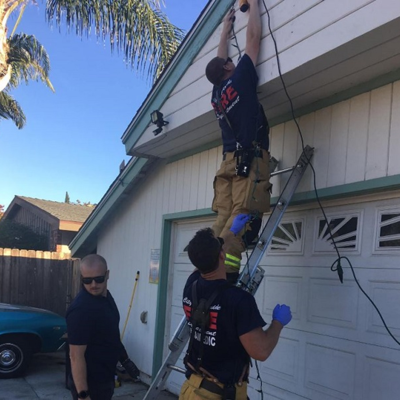 Riverside, CA, firefighters finish putting up Christmas lights after responding to a home when a man fell off a ladder while decorating on Monday, Dec.