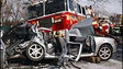 FDNY Fire Truck Crashes Into Passenger Car at Traffic Light