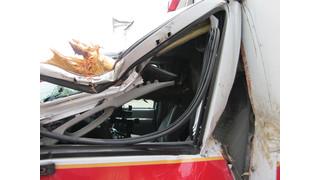Log Impales Cab of Ambulance