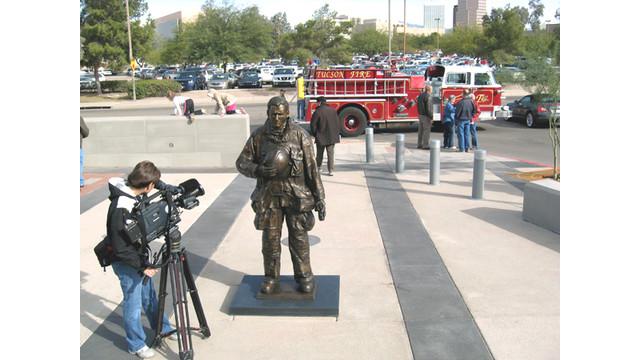 Bronze Firefighter statue Intitled Fall Hero