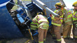 Iowa Crews Extricate Driver from Soybean Hauler