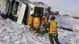 Garbage Truck Rolls, Traps Driver in Colorado