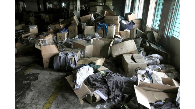 Boxes of garments lay near equipment charred in the fire that killed 112 workers.jpg_10835410.jpg