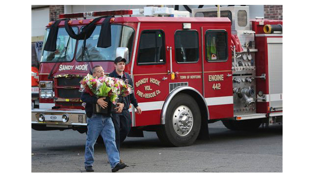 firefighters-flowers-Connecticut-School-Shootings.sff.jpg