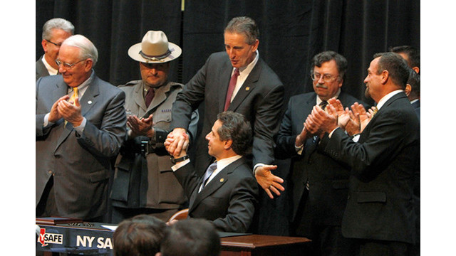 cuomo-signs-bill.png