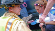 Photo Story: Medics Tend to Dogs After Conn. Crash
