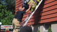 Photo Story: N.J. Firefighters Bailout During House Fire
